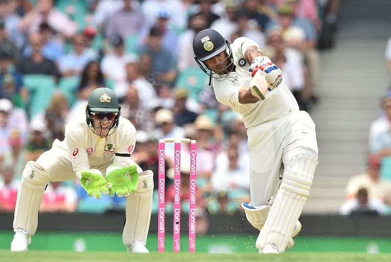 Mayank Agarwal hits a six during the first day of the fourth and final Test against Australia at the Sydney Cricket Ground. Photo by PETER PARKS / AFP