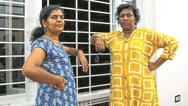 In this photo taken on January 11, 2019, Bindu Ammini (R) and Kanakadurga (L), the two Indian women who entered the Sabarimala Ayyapa temple, pose for photographs during an interview with the media in Kochi in the southern state of Kerala. - Bindu Ammini and Kanakadurga have moved to more than 10 safe houses since they infuriated Hindu traditionalists by entering one of India's holiest temples that for generations banned women of menstruating age. (Photo by STR / AFP) / TO GO WITH India-women-temple-politics,INTERVIEW by Chintha Mary Anil