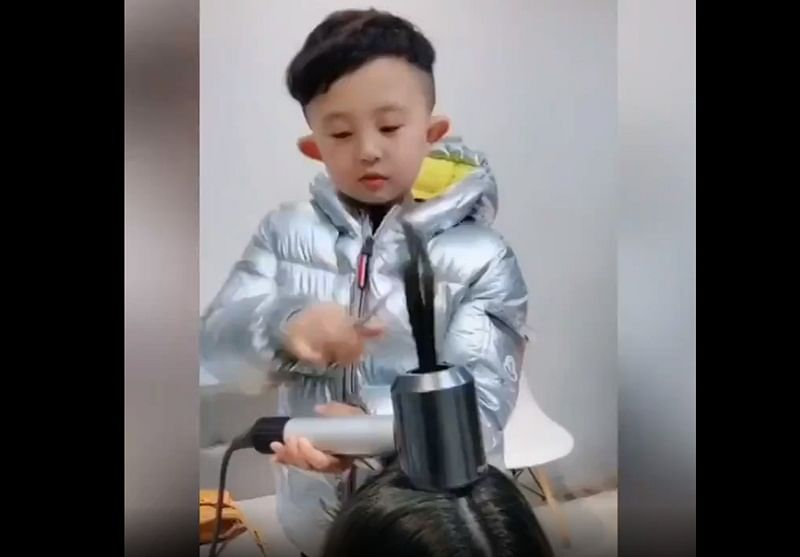 Watch Video! Six-year-old Chinese kid goes viral for giving professional haircut