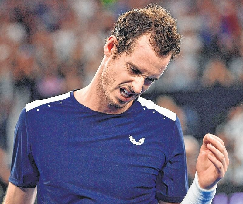 Andy Murray crashes out as Roger Federer, Rafael Nadal fight on