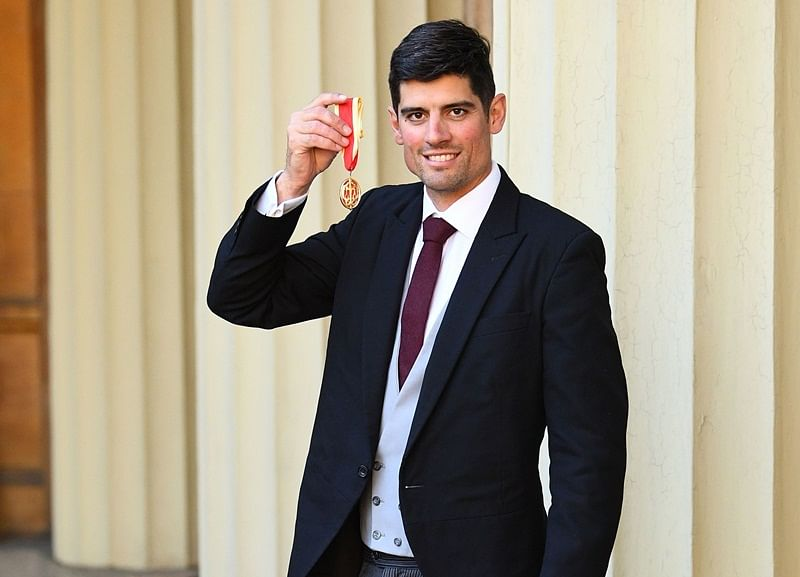Former England cricket captain Alastair Cook poses with his medal after being appointed as a Knights Bachelor (Knighthood) at an investiture ceremony at Buckingham Palace in London on February 26, 2019, for services to cricket. (Photo by Victoria JONES / POOL / AFP)