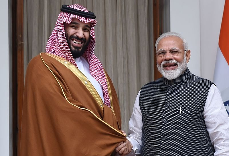 Prime Minister Narendra Modi (R) shakes hands with Saudi Crown Prince Mohammed bin Salman prior to a meeting at Hyderabad House in New Delhi. Photo by MONEY SHARMA / AFP