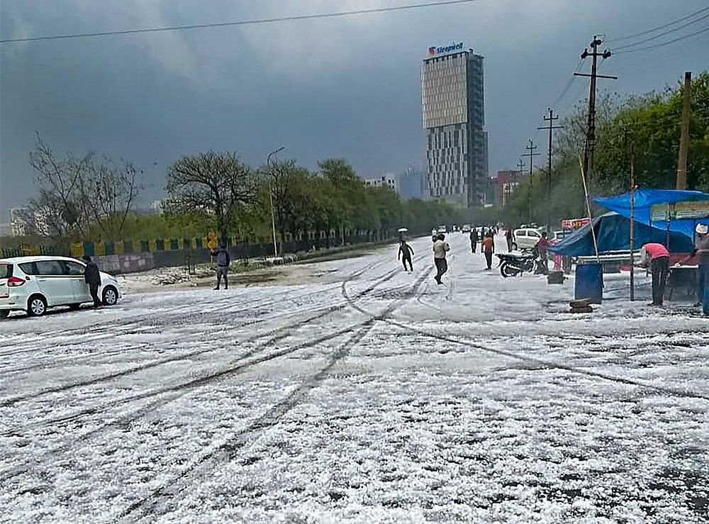 A view of a street after hailstorm struck various parts of Noida,<br />PTI Photo