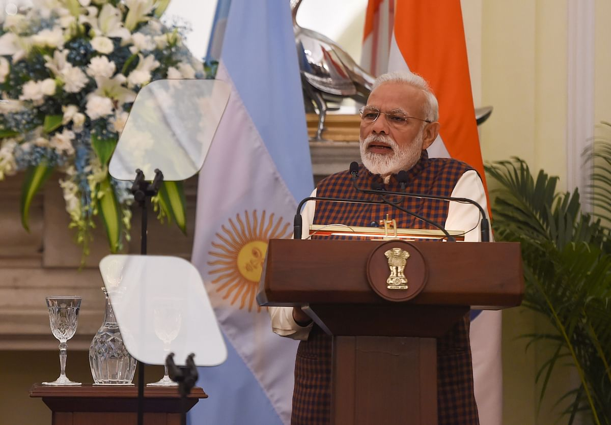 Indian Prime Minister Narendra Modi looks on during a joint press briefing at the Hyderabad House in New Delhi on February 18, 2019. - Macri is on a three-day state visit to India. (Photo by Money SHARMA / AFP)