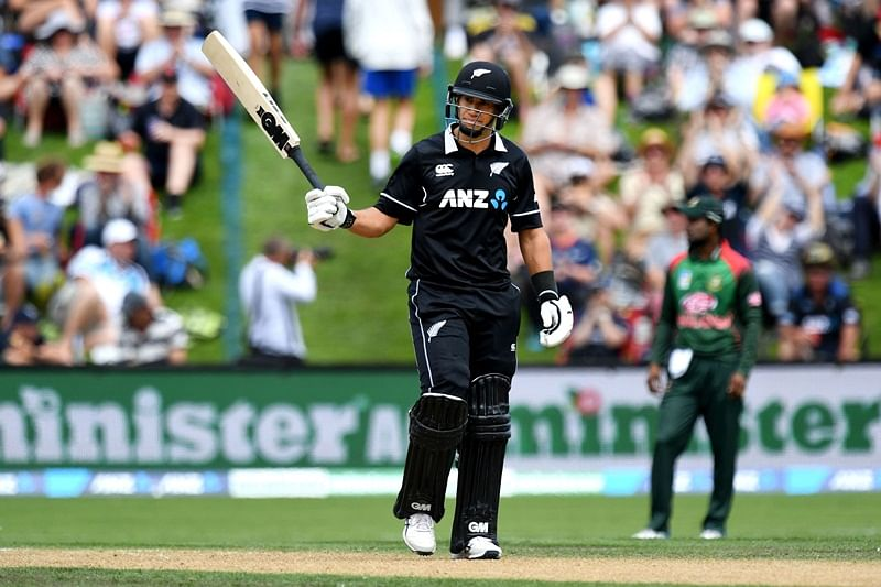 New Zealand's Ross Taylor celebrates scoring a half-century (50 runs) during the third one-day international cricket match between New Zealand and Bangladesh at University Oval in Dunedin on February 20, 2019. (Photo by Marty MELVILLE / AFP)