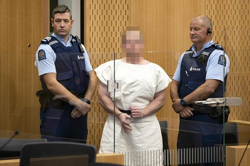 Christchurch mosque attacks: 28-year-old mass shooting suspect charged with murder, smirks in court