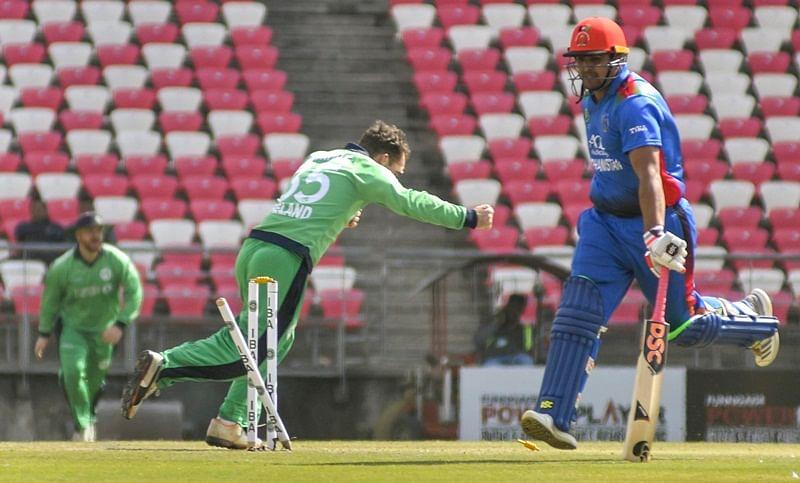 Dehradun: Hazratullah Zazai of Afghanistan is run out during the 3rd ODI cricket match against Ireland in Dehradun, Tuesday, March 5, 2019. (PTI Photo)   (PTI3_5_2019_000118B)