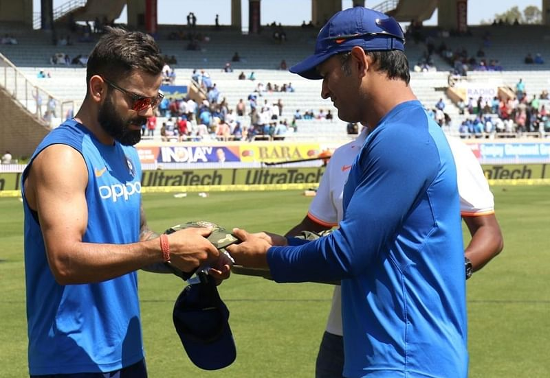 Watch: MS Dhoni distributes special Army caps to Team India ahead of 3rd ODI vs Australia