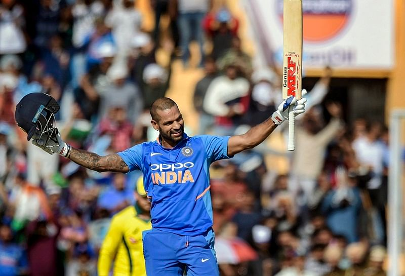 I don't react to criticism as I live in my own world, says Shikhar Dhawan