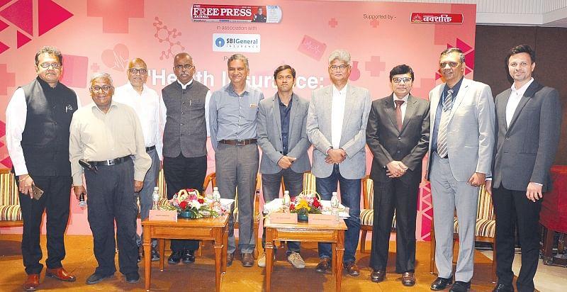 (L to R) Nikhil Apte, Chief Product Officer, Royal Sundaram GIC; R N Bhaskar; Ashok Karnani, Director, FPJ; A Velumani, CMD, Thyrocare; Madan Sabnavis, Chief Economist, CARE Ratings; Rohit Sane, CEO, Madhavbaug; Hiren Ambegaonkar, CEO, S L Raheja Hospital; Pravin Swamy, CEO, Godrej Hospital; Bhaskar Nerurkar, Head, Health Administration Team, Bajaj Allianz GIC & Abhishek Karnani, Director, FPJ.
