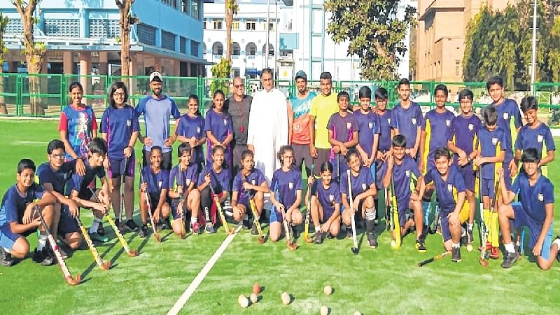 Fr Crispino D'Souza with the budding players and coaches at the venue