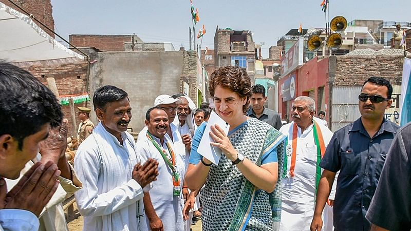 Fatehpur: Congress General Secretary Priyanka Gandhi Vadra greets supporters at an election campaign for Lok Sabha polls, in Gazipur village of Fatehpur, Wednesday, April 24, 2019. (PTI Photo)