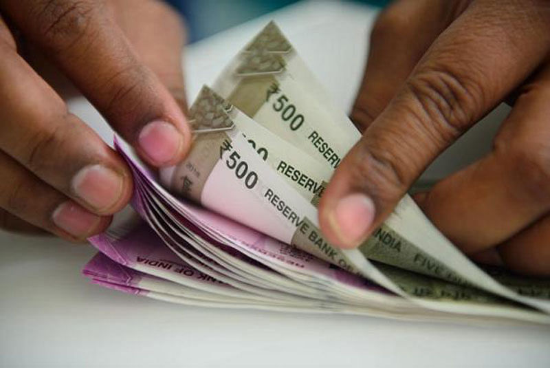 Fund outflows beats Rupee to 69.85 against US dollar