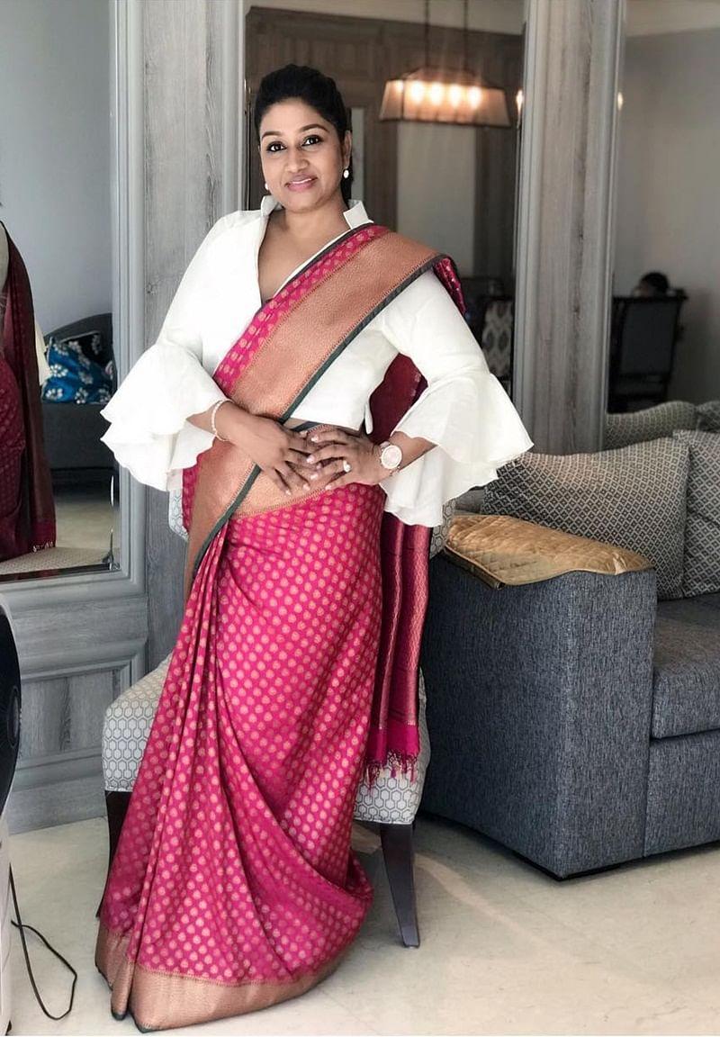 Sari draped on a bell-sleeved shirt