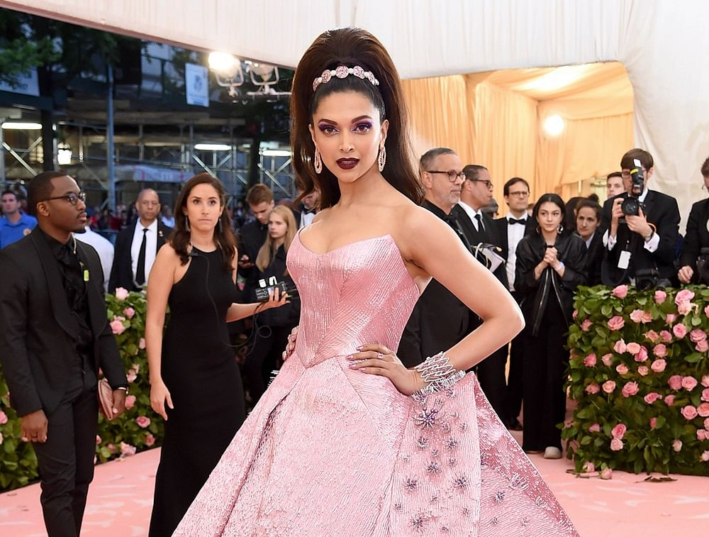 Oops! Watch Deepika Padukone trip while sipping wine on her way to the Met Gala 2019