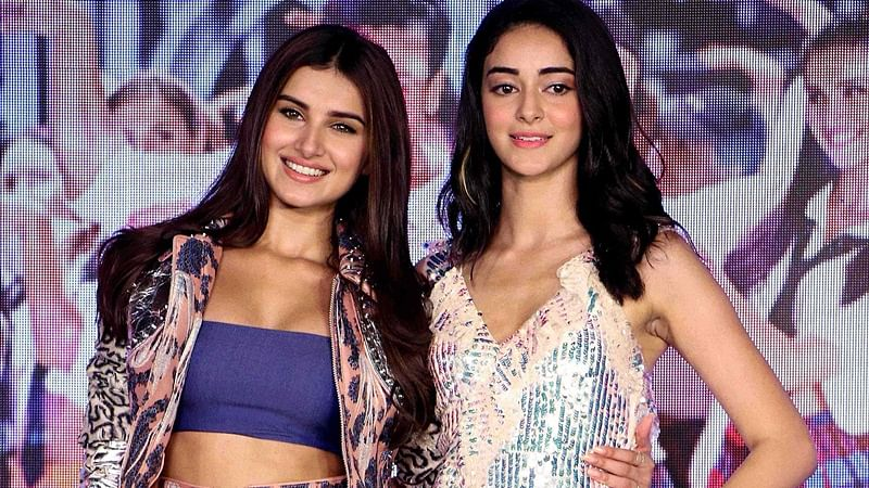 "Indian Bollywood actress Tara Sutaria (L) and Ananya Panday pose during the first song launch of upcoming romantic comedy drama Hindi film ""Student of the Year 2"", in Mumbai on April 18, 2019. (Photo by STR / AFP)"