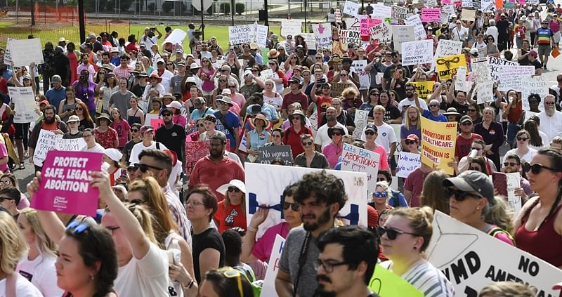 MONTGOMERY, AL - MAY 19: Protestors participate in a rally against one of the nation's most restrictive bans on abortions on May 19, 2019 in Montgomery, Alabama. Demonstrators gathered to protest HB 314, a bill passed by the Alabama Legislature last week making almost all abortion procedures illegal.   Julie Bennett/Getty Images/AFP == FOR NEWSPAPERS, INTERNET, TELCOS & TELEVISION USE ONLY ==