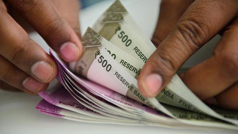 Rupee rises 8 paise to 69.38 versus USD in early trade