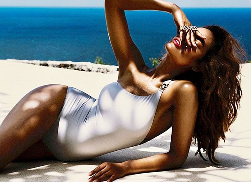 Esha Gupta is all about summer love as she basks in sun wearing a snug white swimsuit
