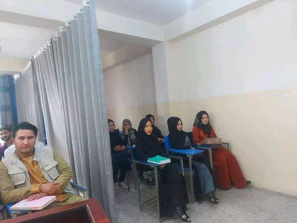 Classes resume in Afghanistan universities, female and male students  separated by curtains