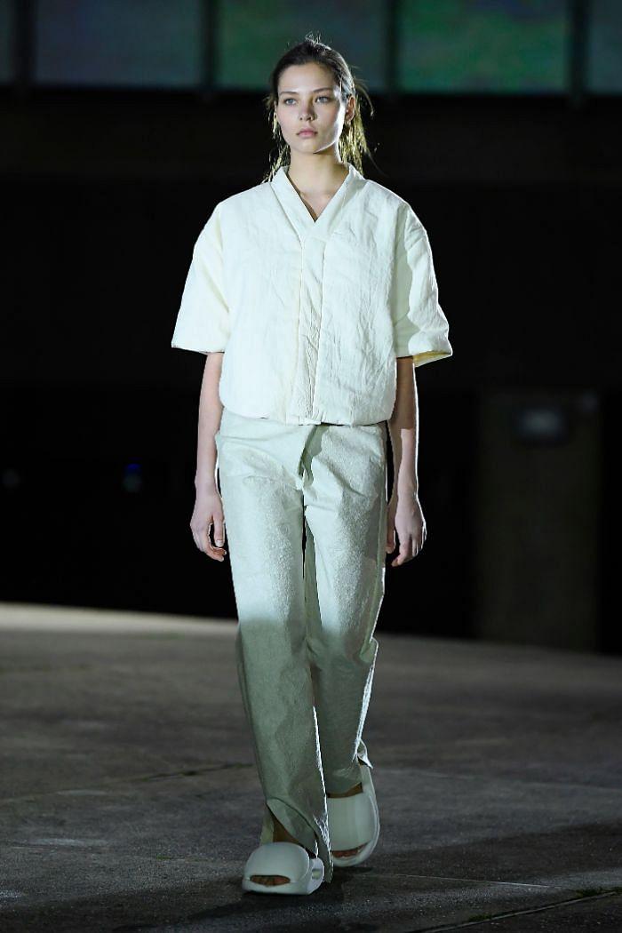 Model sporting Yeezy slides at Paris Fashion Week