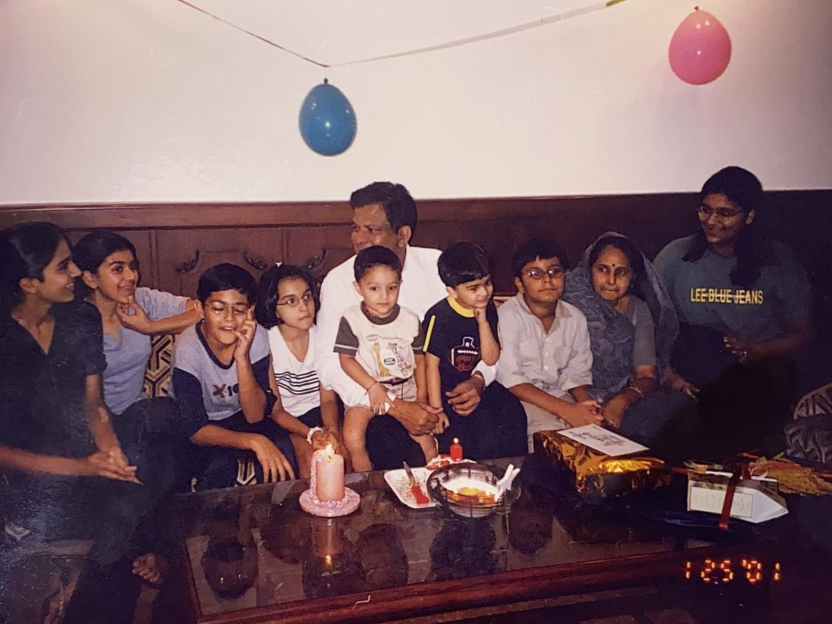 Adi (5th from left) with his family