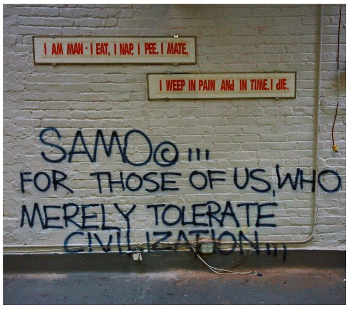 Graffiti by SAMO, AKA Basquiat.