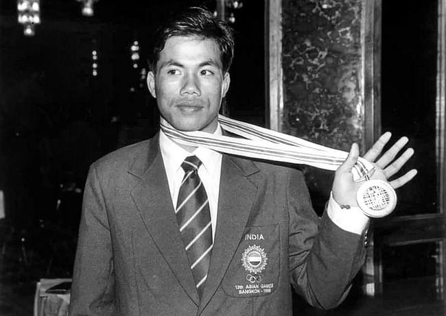 Dingko Singh winning the gold medal in 1988