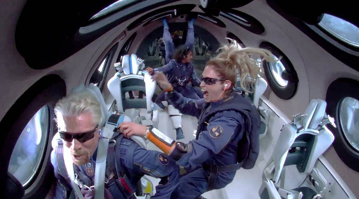 This is a still from a video inside the cockpit showing the crew celebrating