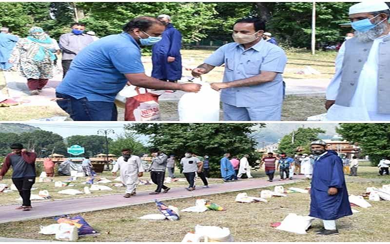 Tourism department distributes food kits at Rajbagh