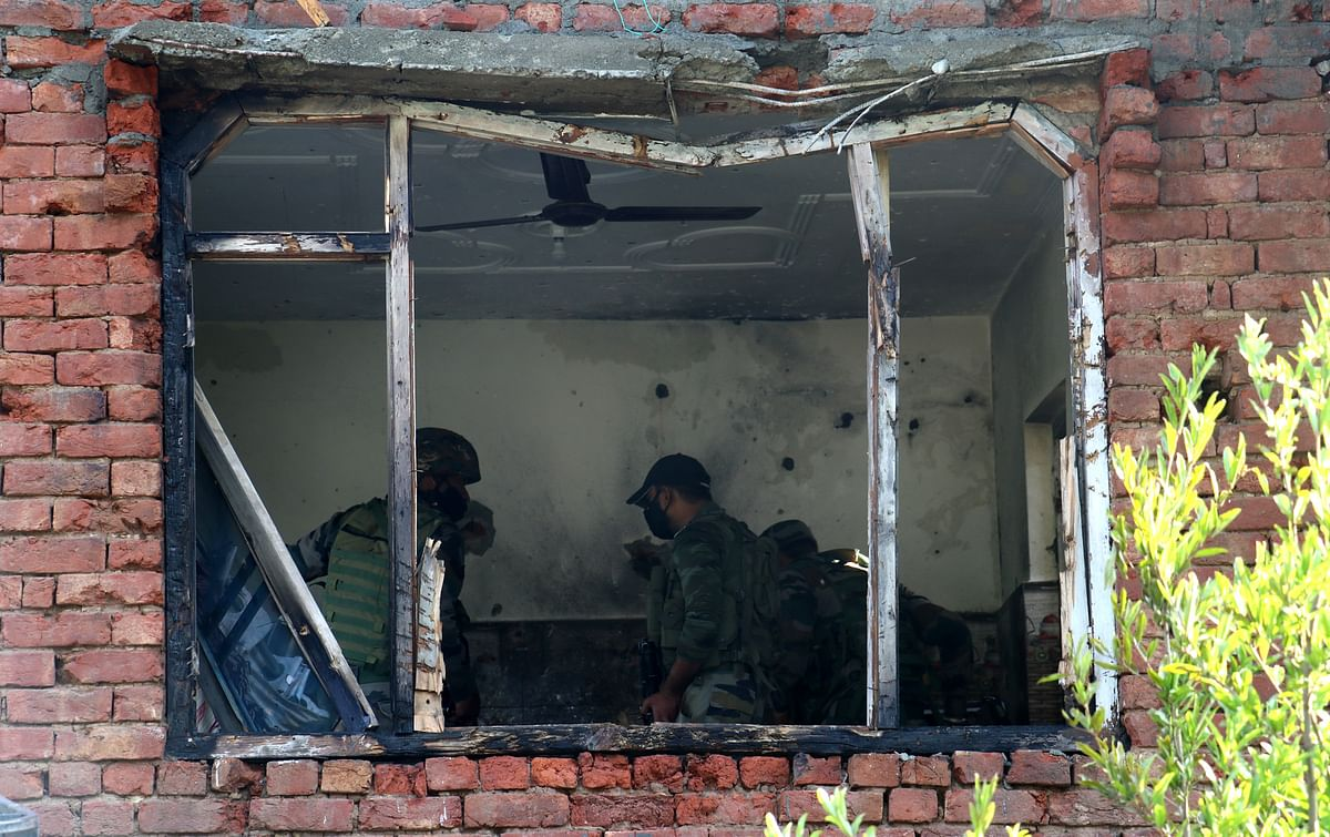Security forces examine the gunfight site after it ended on Tuesday 29 June 2021.