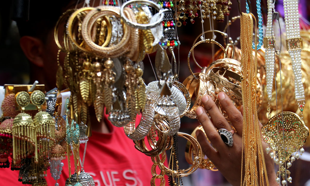 Shops selling artificial jewelry saw of rush of women visitors on the eve of Eid-ul-Adha in Srinagar on Tuesday, 20 July 2021.