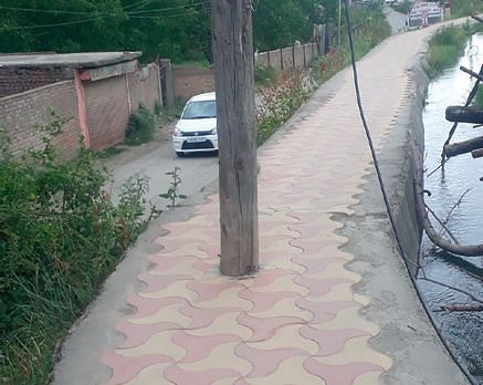 Electric poles in the middle of footpaths