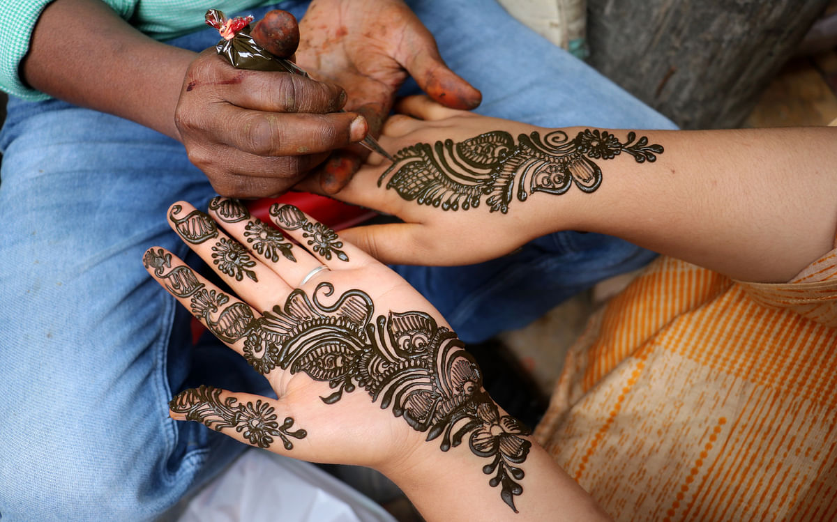 A woman gets henna applied on her hands on the eve of Eid-ul-Adha in Srinagar on Tuesday, 20 July 2021.