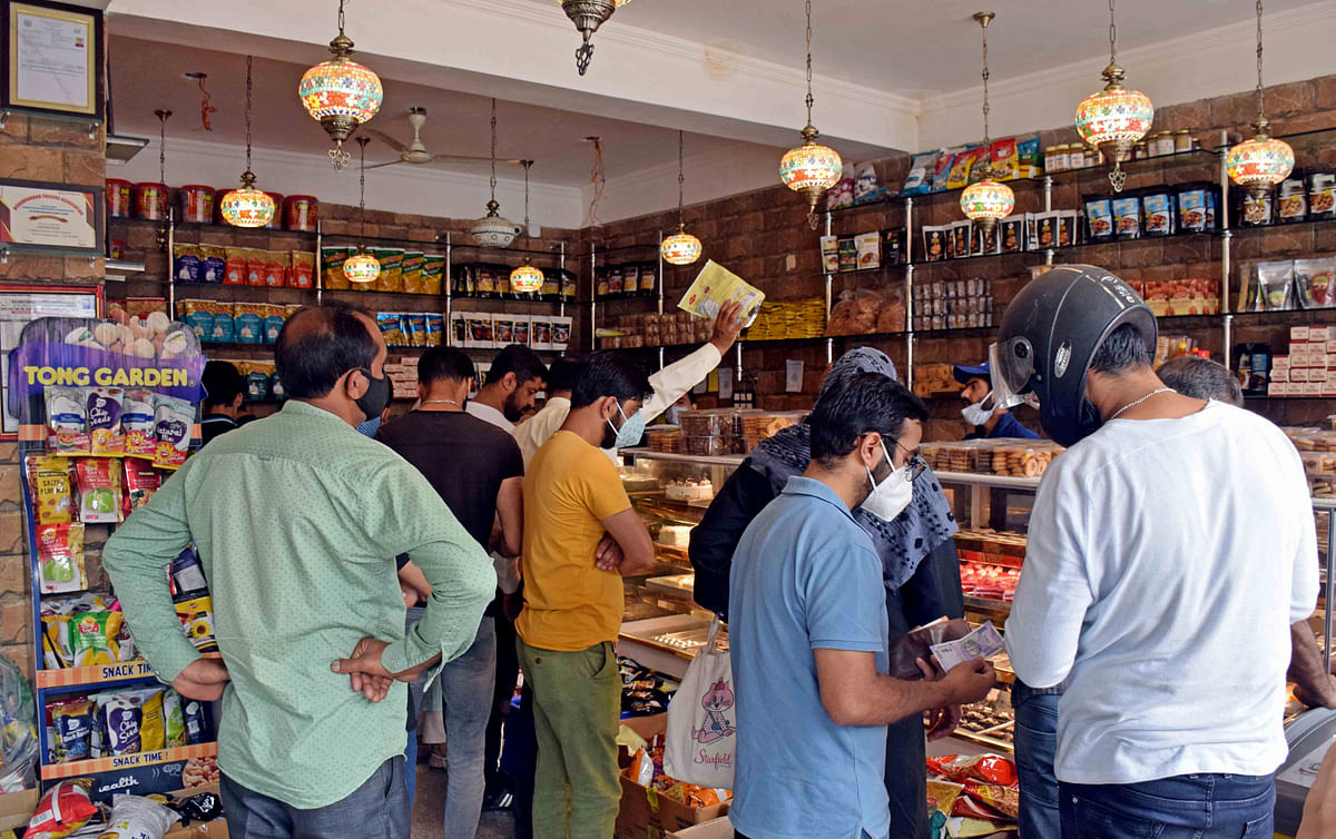 People buy bakery and sweets at a shop in Srinagar on the eve of Eid-ul-Adha.