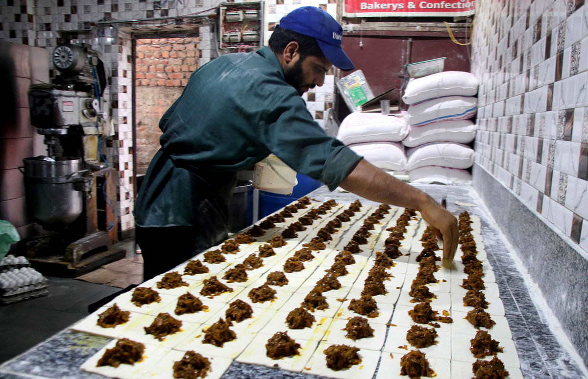 A baker works at his shop in Srinagar ahead of Eid-ul-Adha which witnesses a huge spike in sales of bakery products.