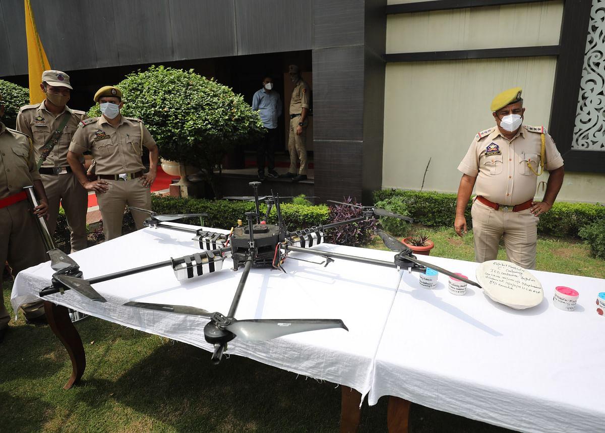 Policemen pose with the drone shot down earlier today in Akhnoor.