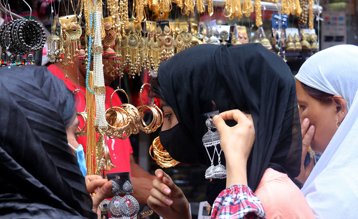 Women shop for earrings on the eve of Eid-ul-Adha in Srinagar on Tuesday, 20 July 2021.