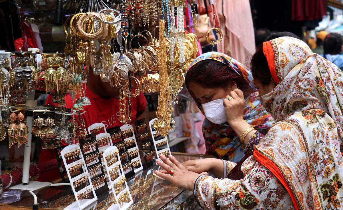 Women shop at a market in Srinagar on the eve of Eid-ul-Adha in Srinagar on Tuesday, 20 July 2021.
