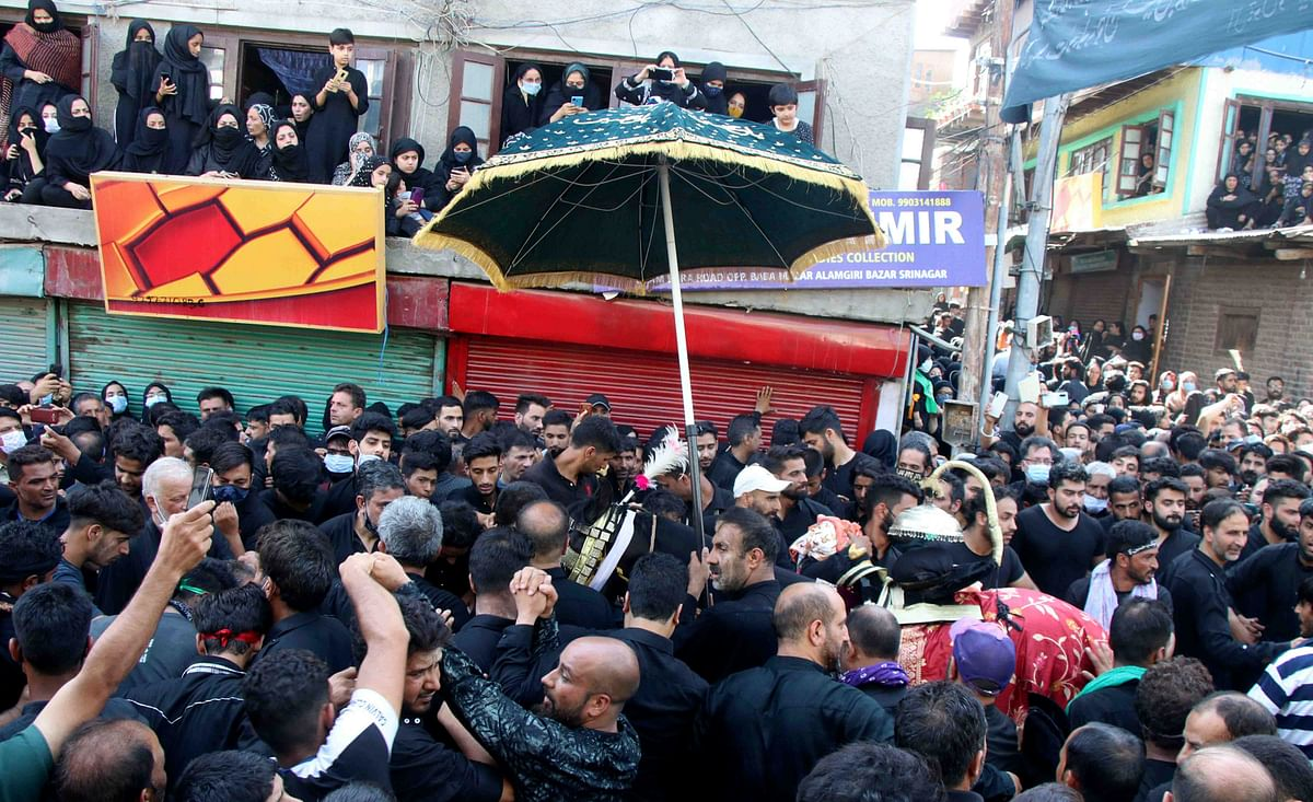 Thousands of Shia mourners participated in Alam and Zuljanah processions across J&K.
