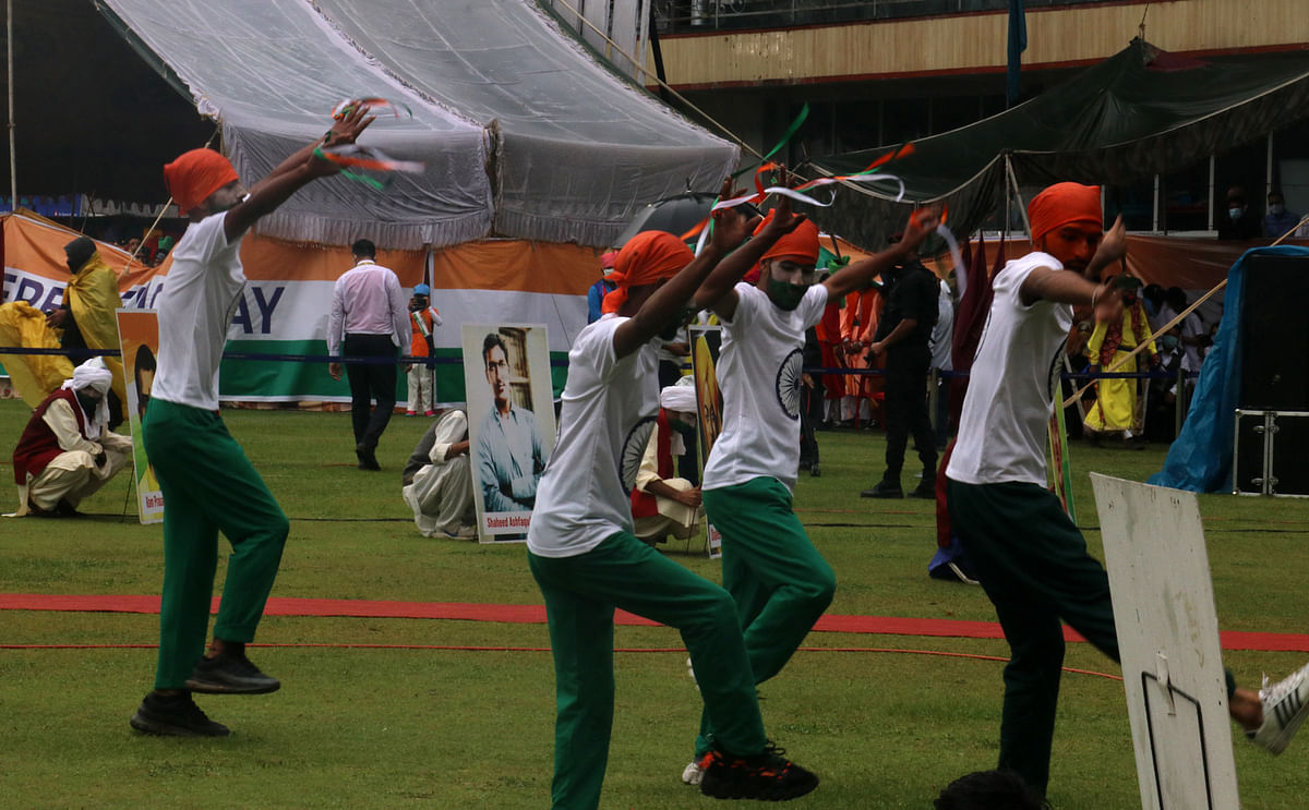 Artists perform during the 75th Independence Day celebrations at Sher-i-Kashmir, Cricket Stadium on Sunday, 15 August 2021.