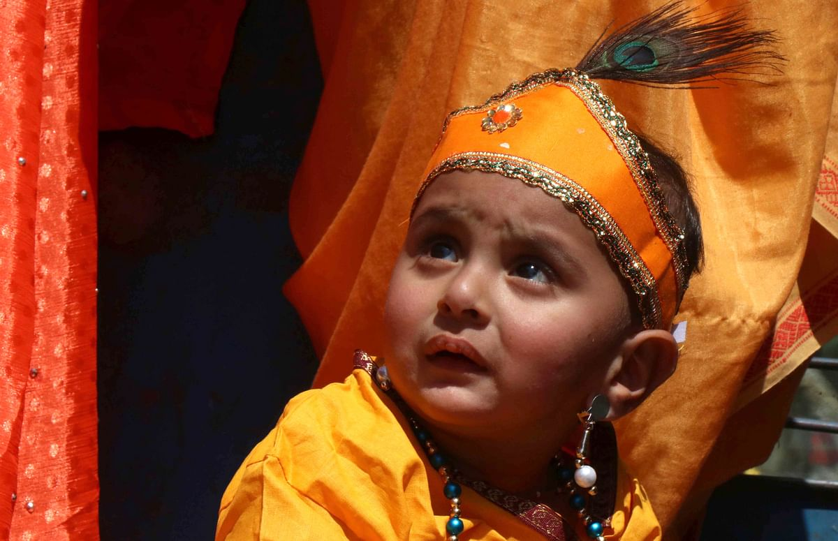 The devotees, including men, women and children, danced alongside the chariot and distributed sweets among people.