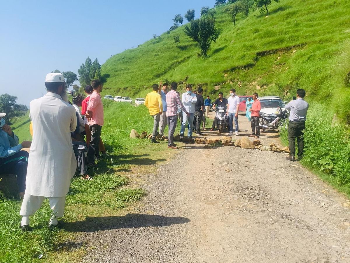 Locals hold protest to demand repair of approach road to BGSBU Rajouri