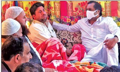 Sajad Lone visits slain cop's family in Kupwara