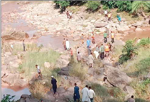 Woman washed away in flash floods