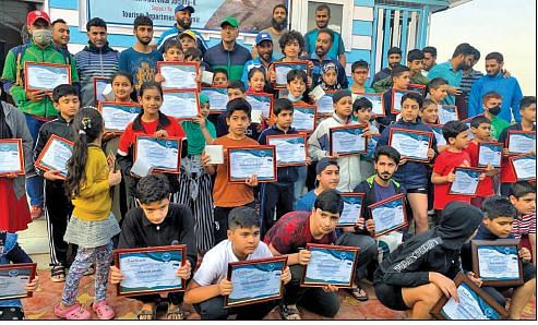 Swim N Survive Society distributes certificates among swimmers