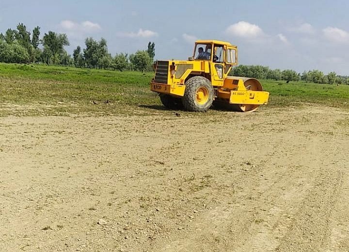 A roller leveling the 'Dagital' cricket ground at Daharmuna in central Kashmir's Budgam district.