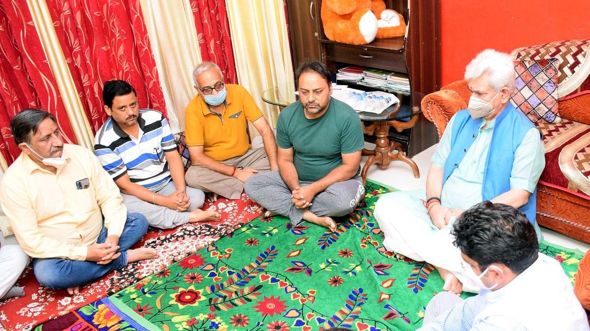 LG visits slain teacher Deepak Chand's family in Jammu, offers condolence