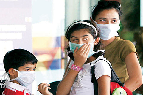 'Stay at arm's length from persons coughing or sneezing, wash hands to check H1N1 spread'