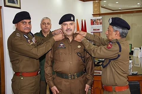 DGP decorates  SP Gulzar Ahmed